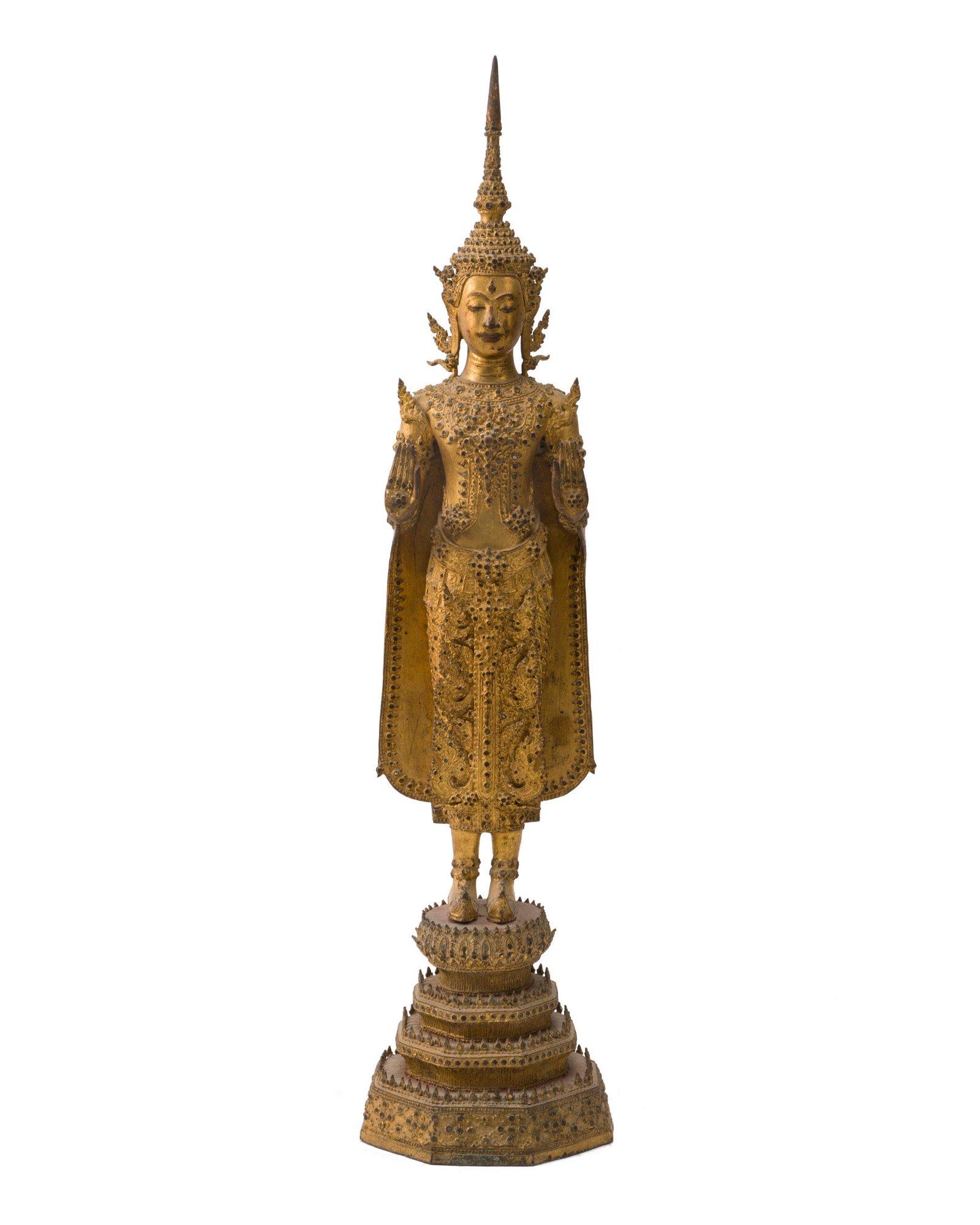A Tibetan gilt-bronze figure