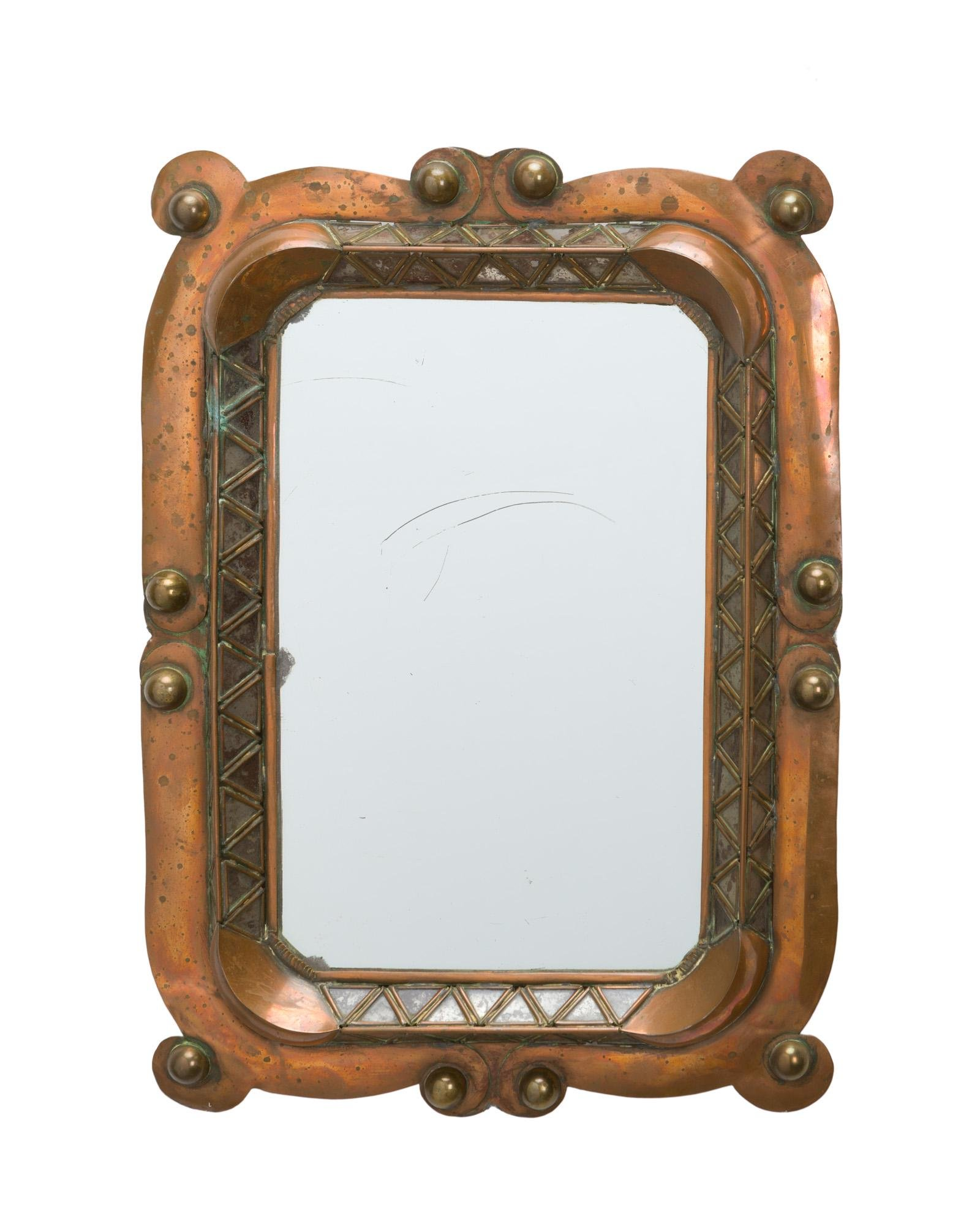 A Mexican copper and brass wall mirror