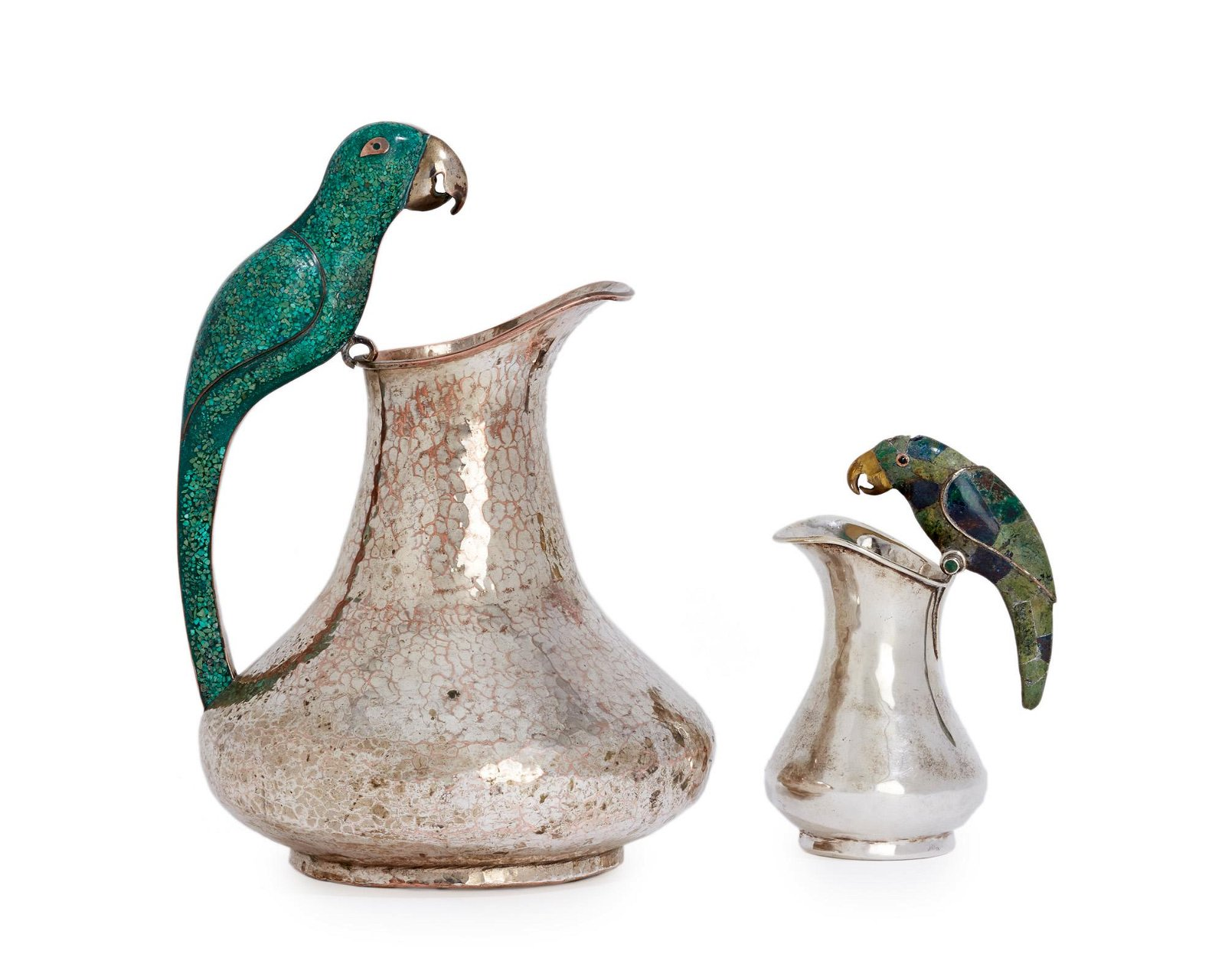 Two Los Castillo silver-plated parrot pitchers