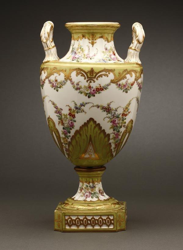 1003: A Sevres style porcelain double-handled vase