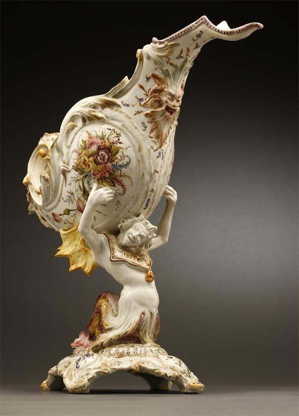1009: A Continental majolica figural centerpiece Triton