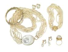 A group of various pearl jewelry