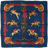 A blue Hermes Jumping silk scarf