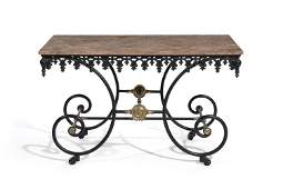 A wrought-iron and marble French pastry table