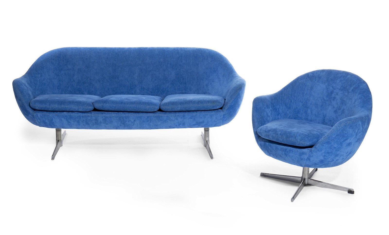 A custom blue upholstered sofa and armchair