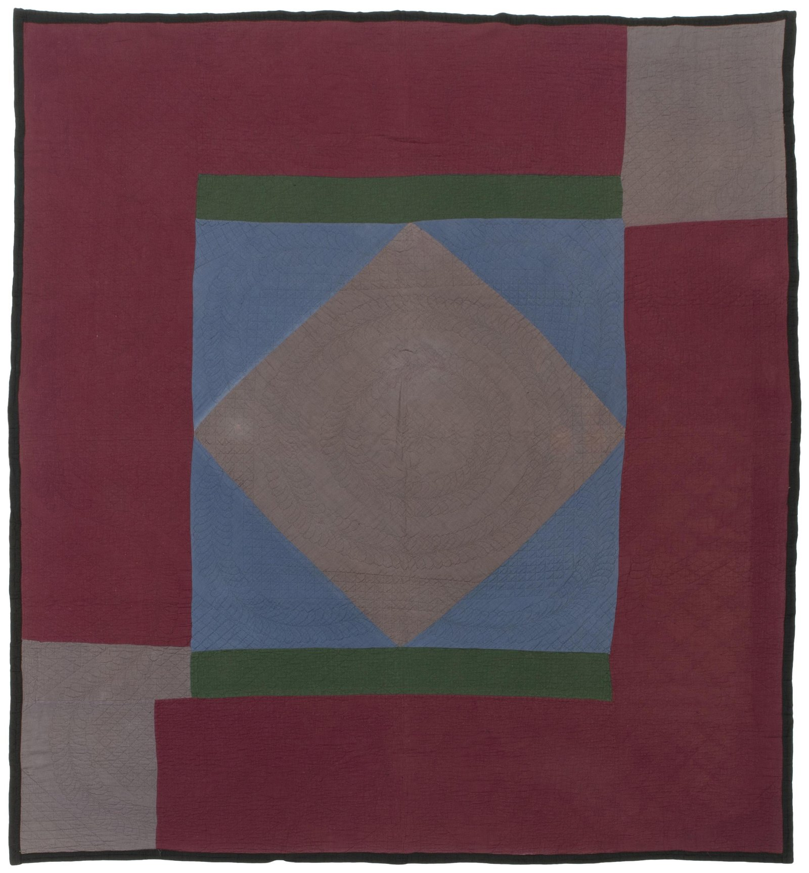 An Amish Diamond in the Square quilt