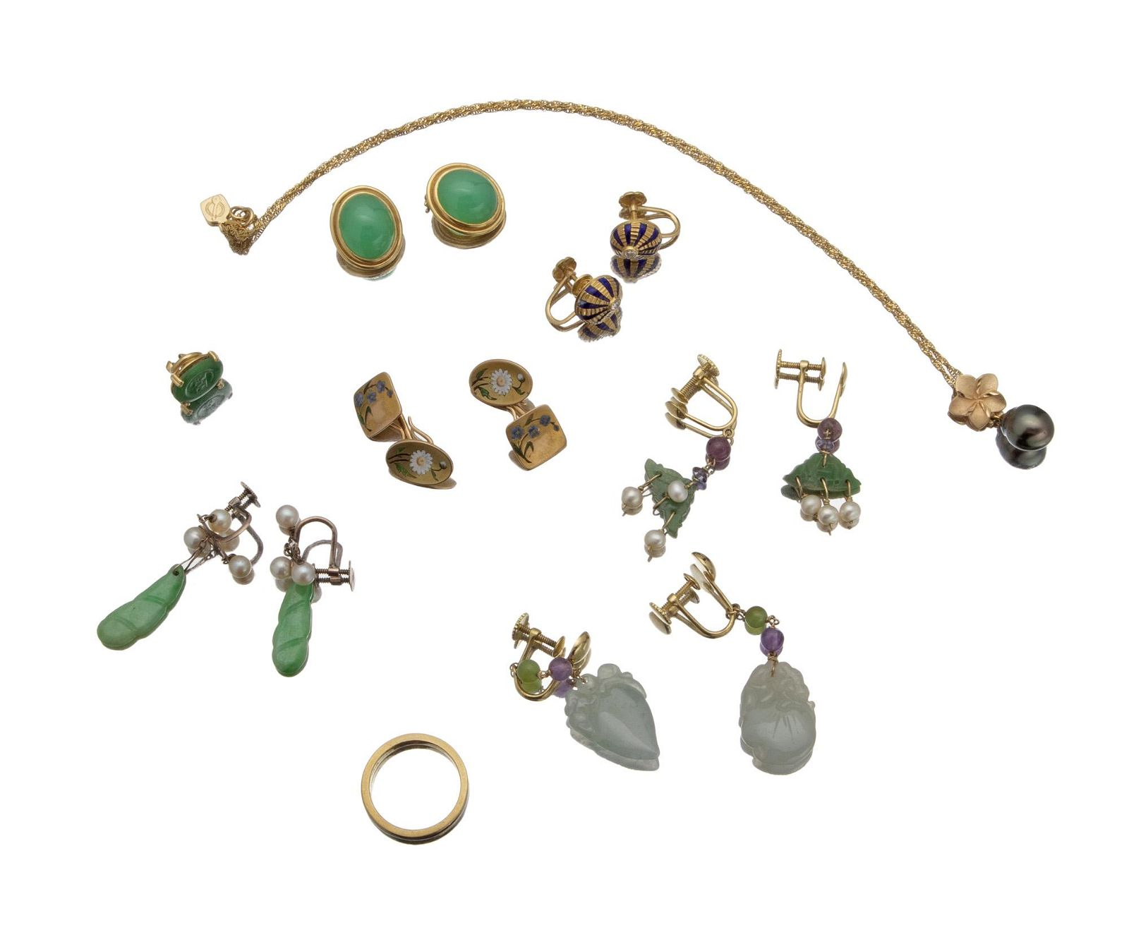 A group of gold jewelry items