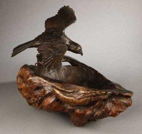 2011: A Japanese bronze hawk on burr wood base