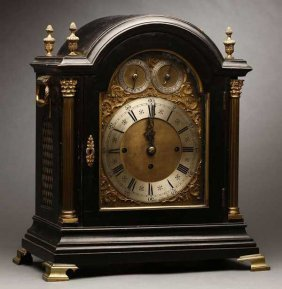 A Georgian Style Ebonized Mantel Clock