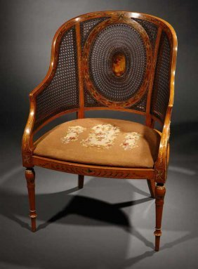 2018: An Edwardian painted satinwood caned bergere