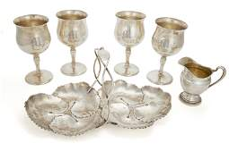 Six silver table articles