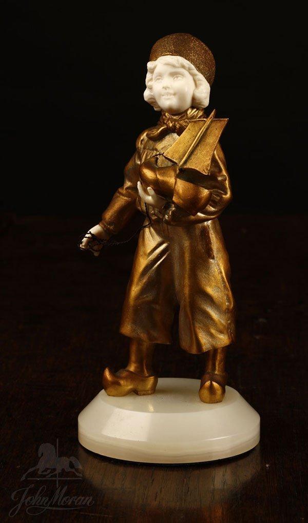 1002: After Rene Marquet bronze ivory figure Shoeboat