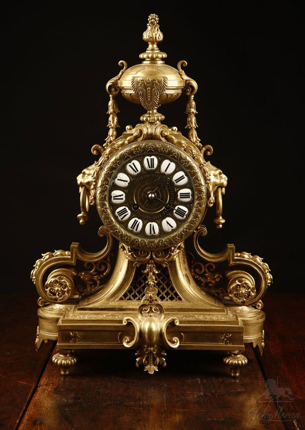 1004: A Louis XVI style lacquered bronze mantel clock