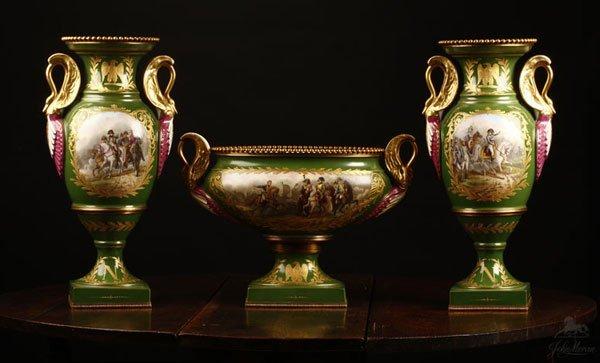 1005: A Sevres style green ground garniture vases urn