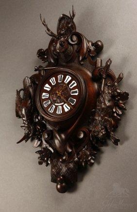 1007: French carved walnut hunting trophy cartel clock