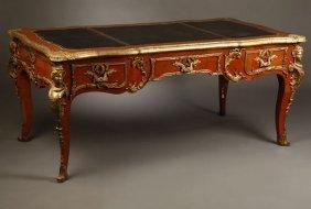 1011: A Louis XV style gilt bronze-mounted bureau plat