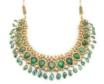 An Indian carved emerald and diamond necklace