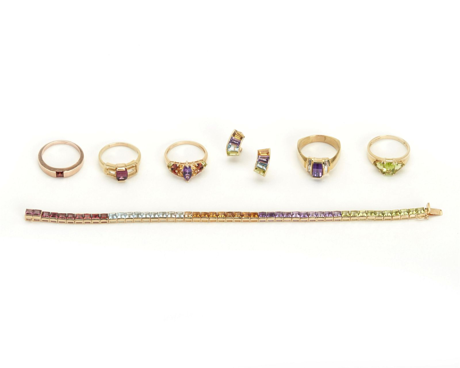 A group of multi-colored gem-set jewelry