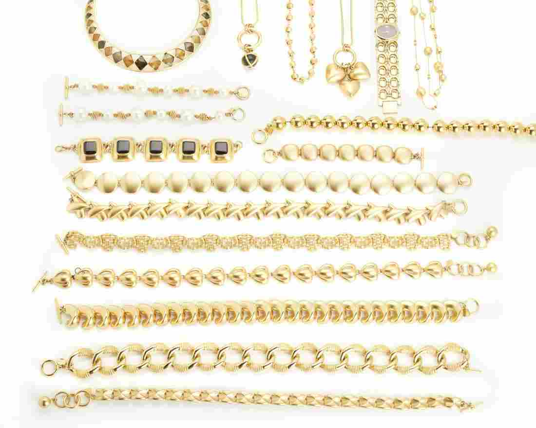 A large group of gold-toned Anne Klein costume jewelry