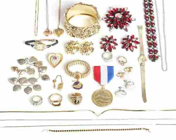 A large group of gold and costume jewelry