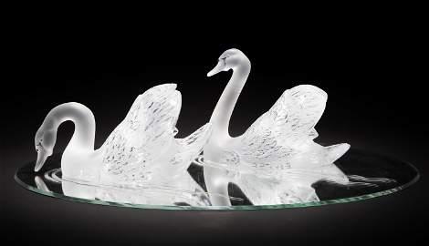 A pair of Lalique art glass swans