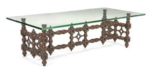 A Moroccan-style rectangular carved wood cocktail table