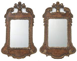 A pair of English carved and giltwood wall mirrors