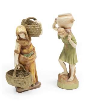 A pair of Amphora figural vessels