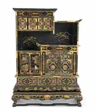 A Japanese decorative table top cabinet