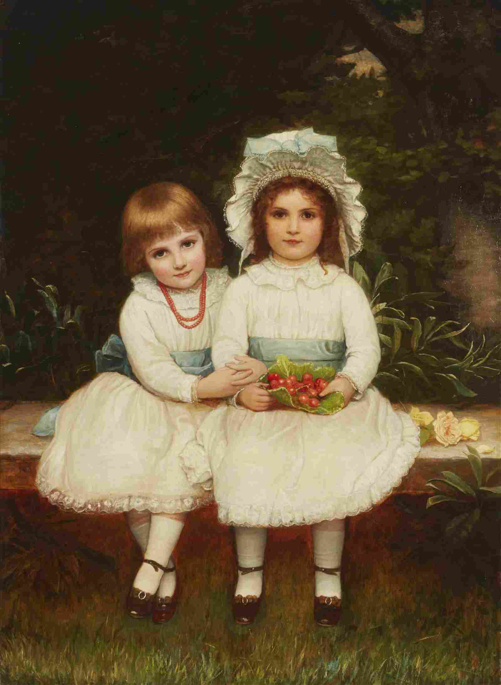 Portrait of two young girls sitting in the garden