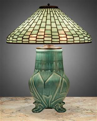 A Tiffany Studios leaded glass and Rookwood pottery