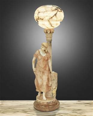 A Greco-Roman-style carved soft stone floor lamp