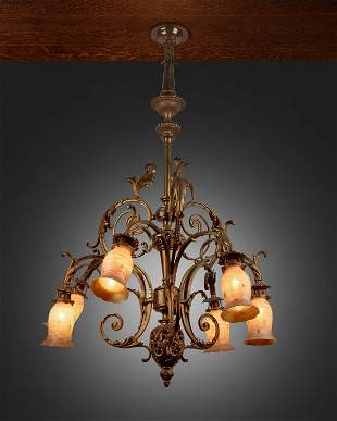 A Rococo-style gilt-bronze chandelier with Quezal art
