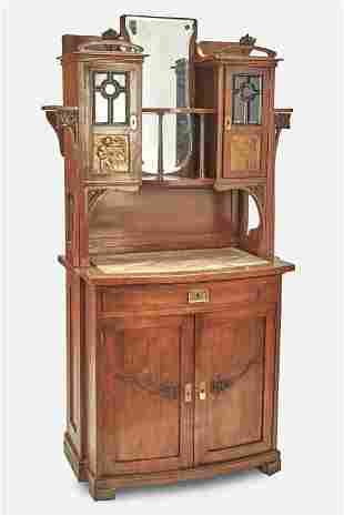 An Art Nouveau walnut curio cabinet