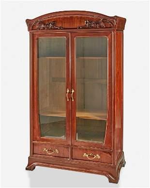 An Art Nouveau walnut double-door bookcase