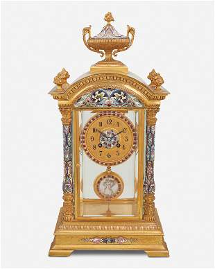 A French gilt-bronze and champleve mantel clock