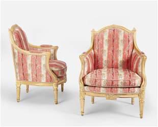 A pair of Louis XVI-style carved giltwood armchairs