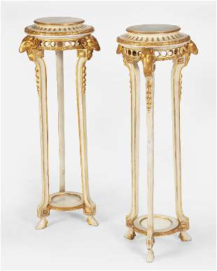 A pair of Regency-style carved giltwood plant stands