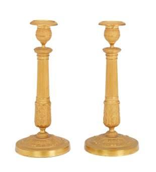A pair of French Empire gilt-bronze candlesticks