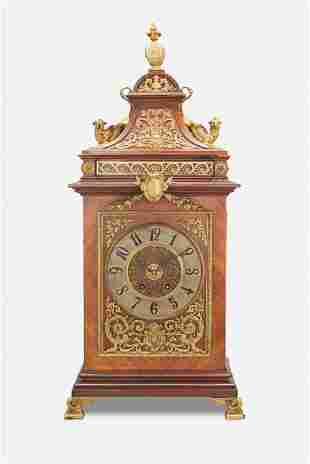 A French gilt-bronze mounted wood mantel clock