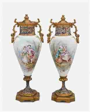A pair of French Sevres-style porcelain and champleve