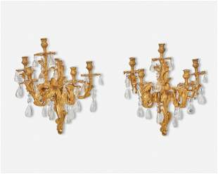 A pair of French Louis XV-style gilt-bronze wall
