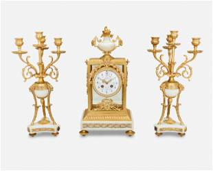 A French Samuel Marti gilt-bronze mantel clock with