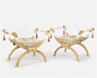 A pair of French-style carved giltwood curule seats
