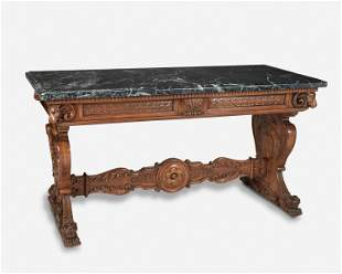 A Renaissance Revival carved walnut library table