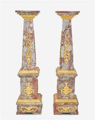A pair of gilt-bronze and marble pedestals