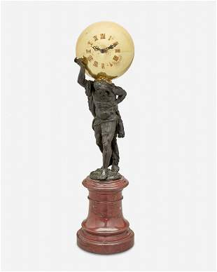 A French bronze and brass mantel clock
