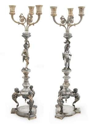 A pair of German silver three-light candelabra
