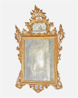 A Venetian carved giltwood wall mirror