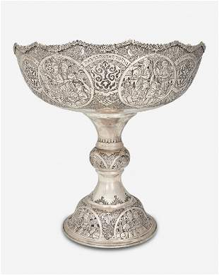 A Persian repousse silver punch bowl